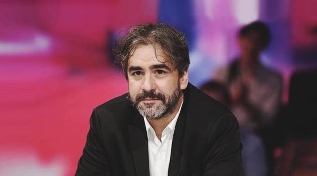 журналист Дениз Юджель