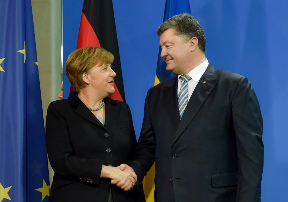 порошенко и меркель.