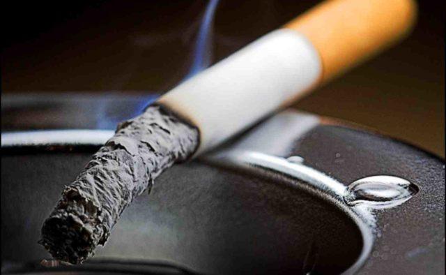 сигарета.