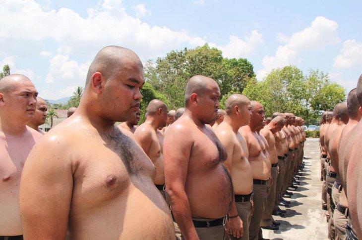 таиланские полицейские.