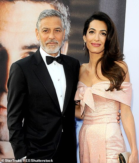 Клуни с супругой